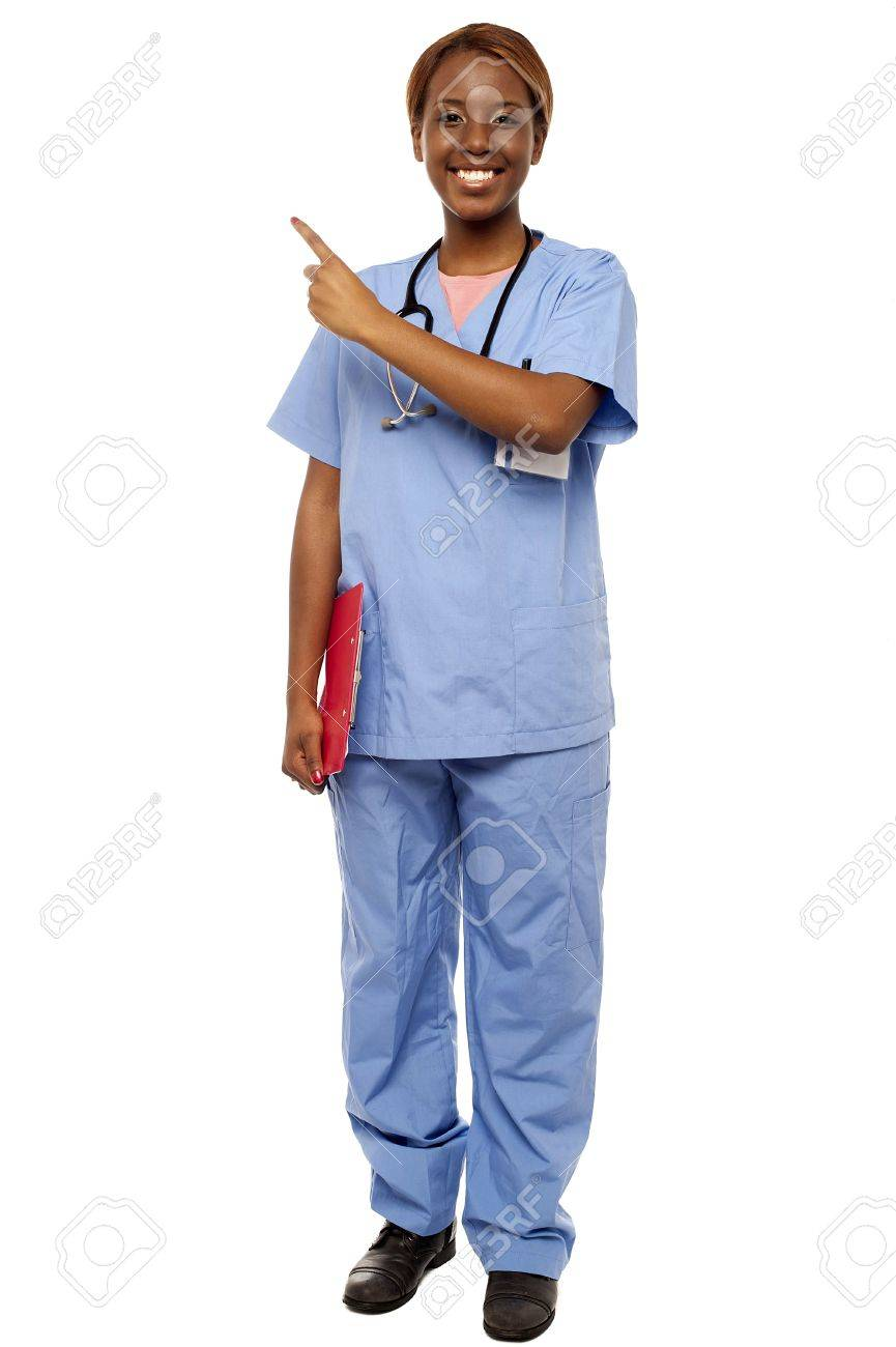 Female doctor pointing at copy space, holding clipboard. Full length portrait Stock Photo - 15137714