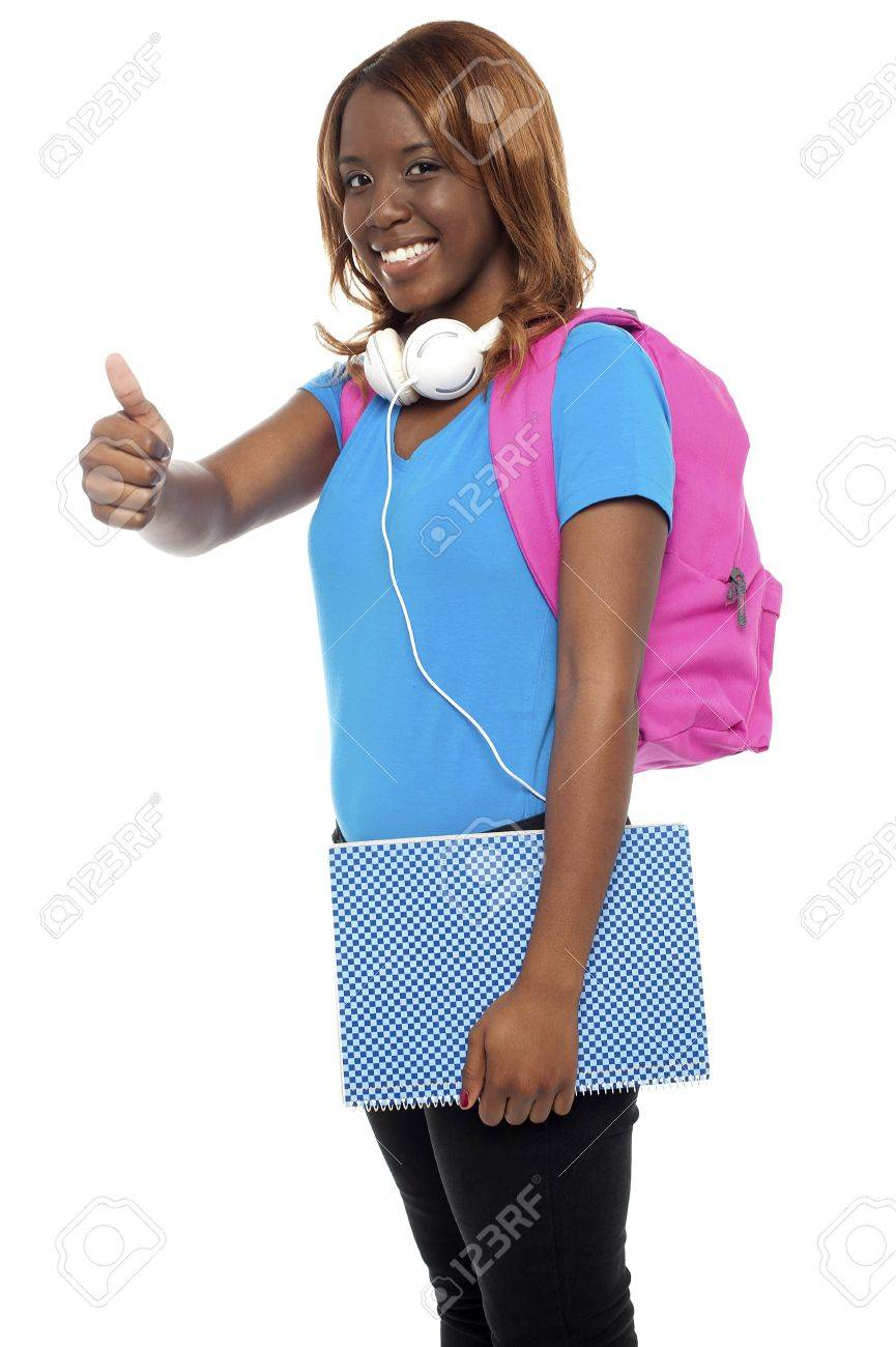 Stylish african college girl showing thumbs up to camera. All on white background Stock Photo - 15138491