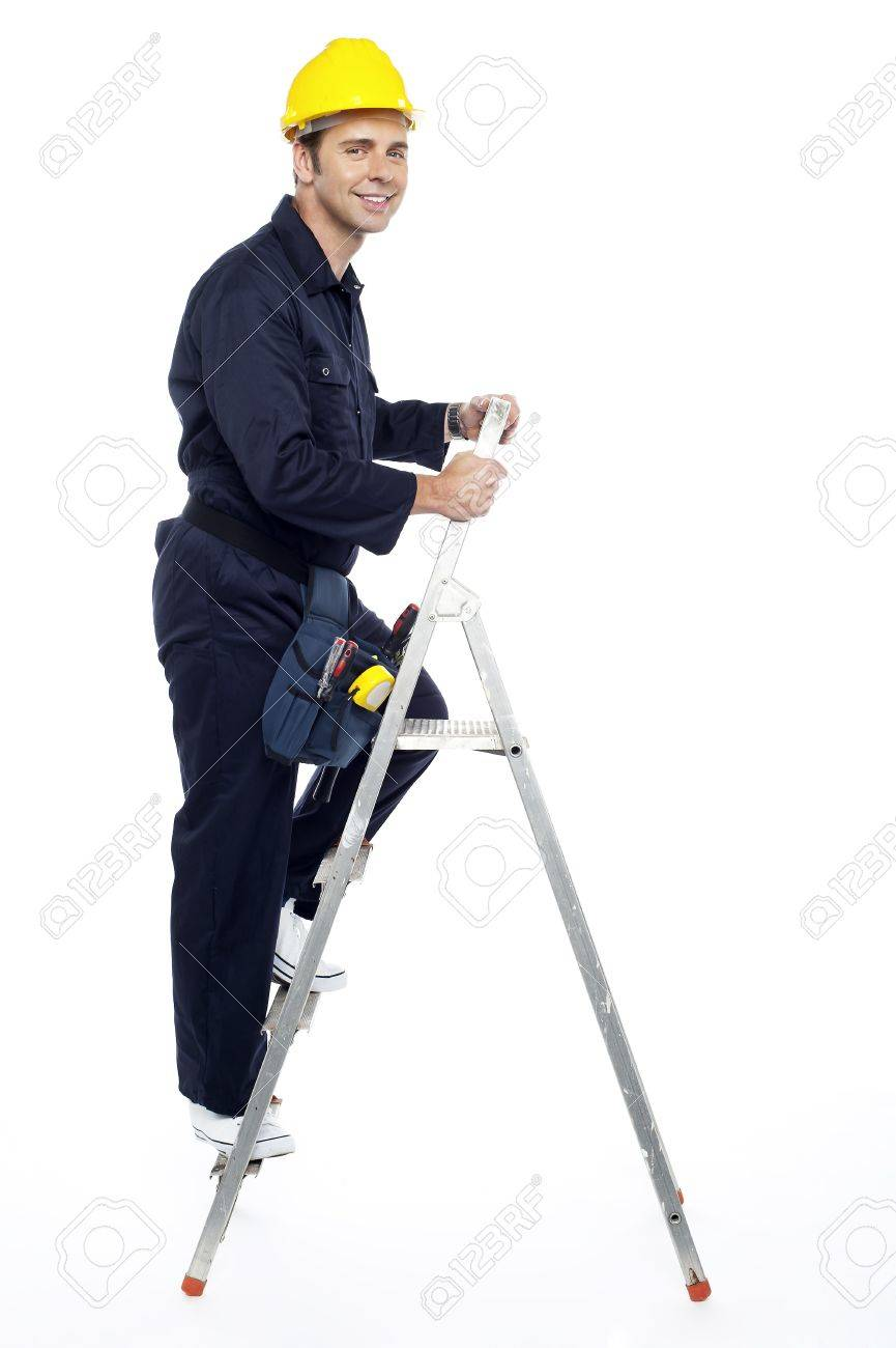 Industrial employee stepping up the ladder and looking at you Stock Photo - 15243273