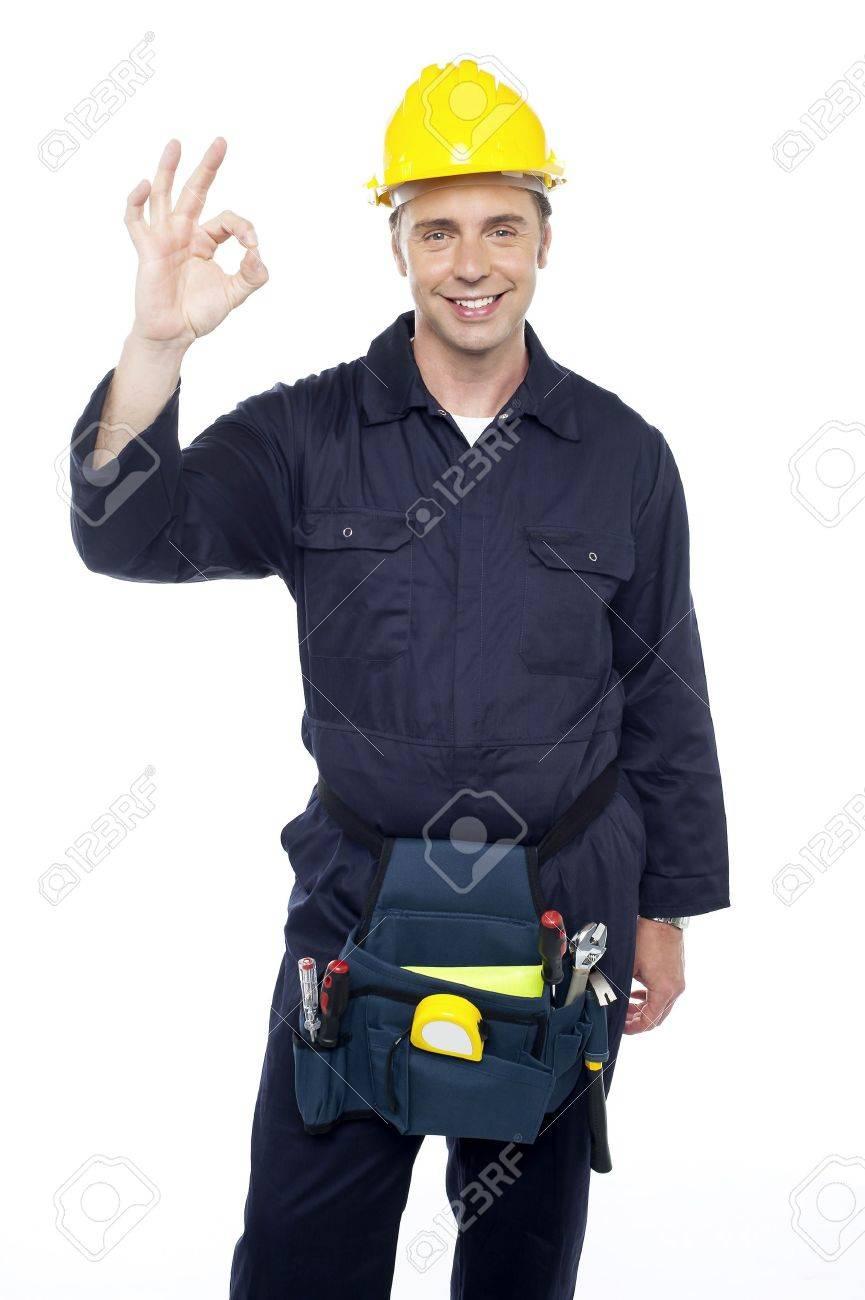 Senior repairman showing good work done sign to his subordinates Stock Photo - 15243837