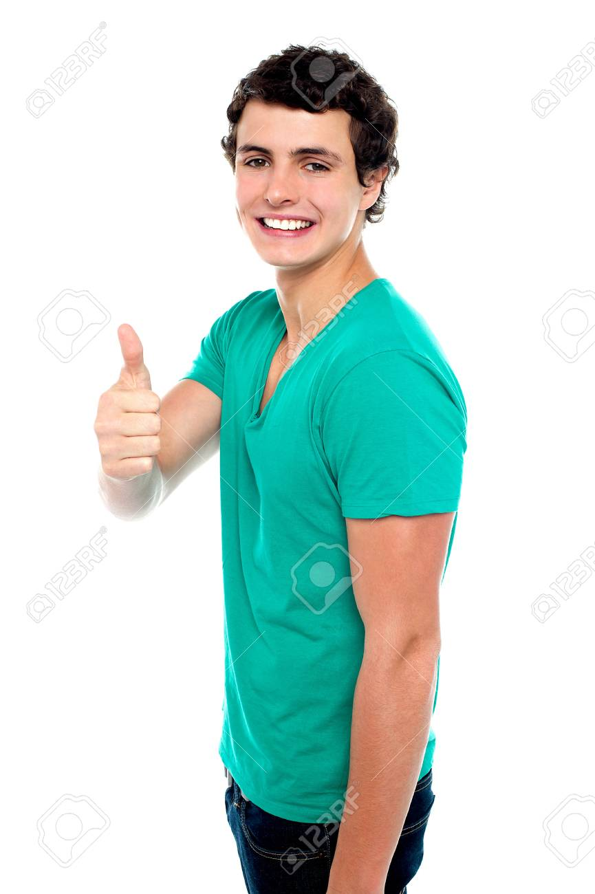 Cheerful teenager showing thumbs up to camera isolated against white background Stock Photo - 15714958