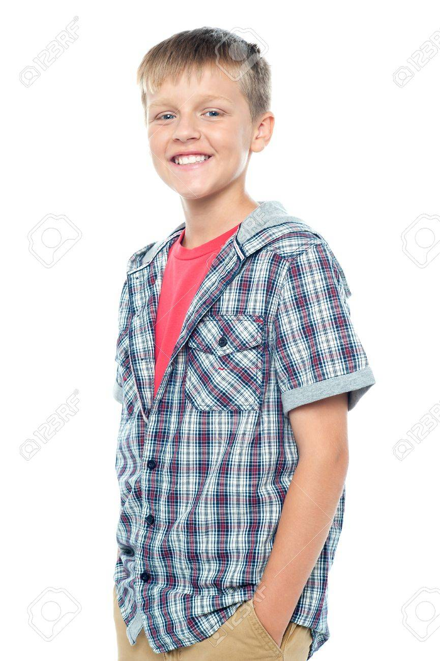 Profile shot of smart young boy posing casually. Hands in his trousers pocket Stock Photo - 15895644