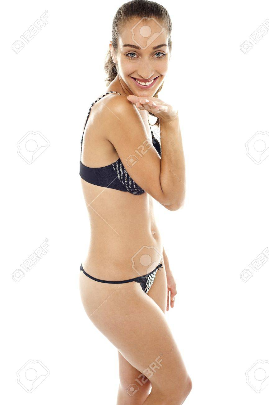 Sexy bikini woman giving flying kiss to you. Isolated against white background. Stock Photo - 16469271