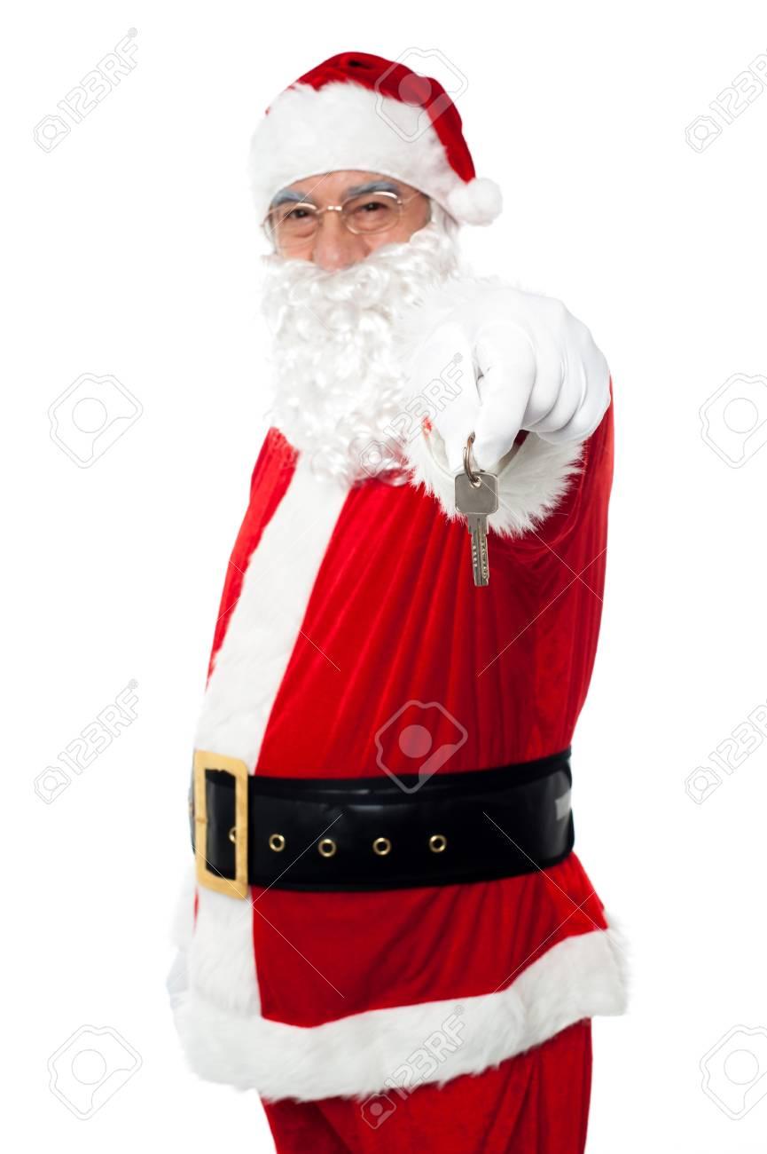 Aged Santa dangling a key. Unlock your X-mas gifts. Stock Photo - 16510243