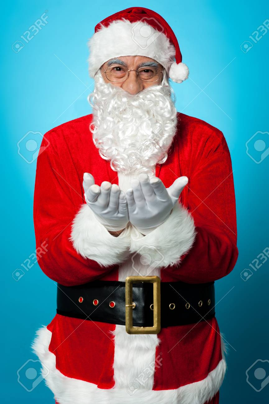 Santa praying peace and happiness for all isolated against blue background. Stock Photo - 16511110