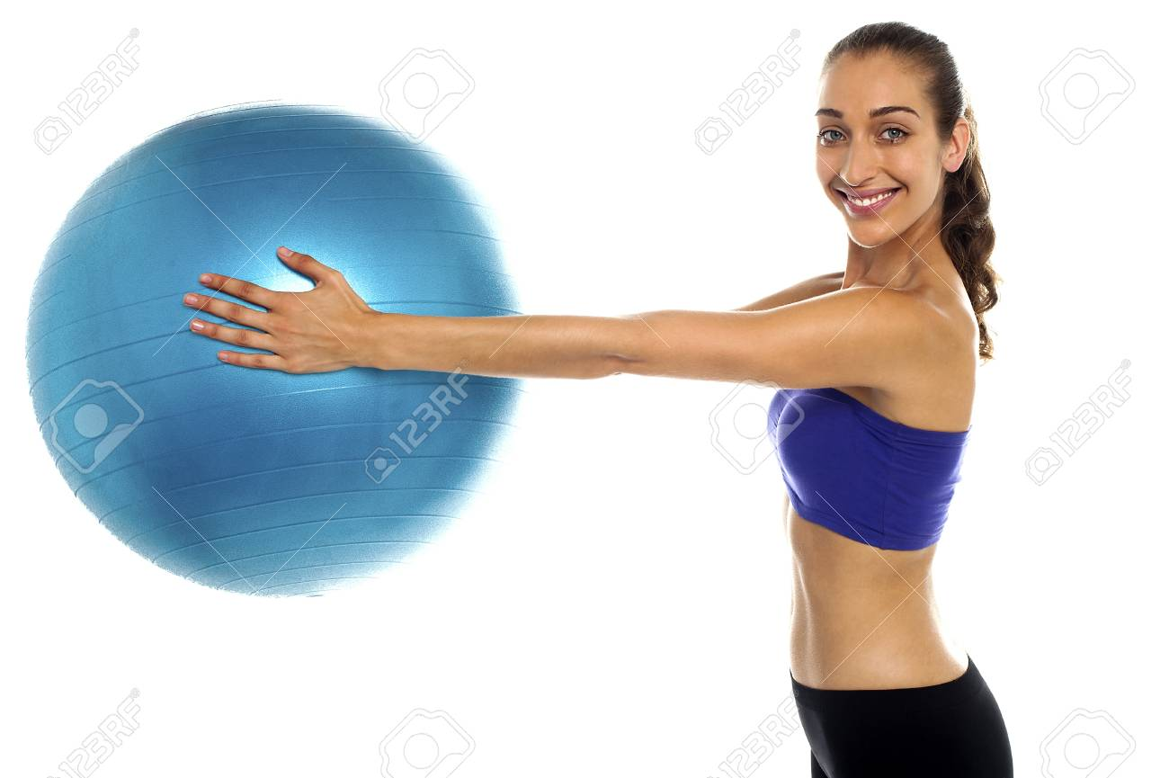 Side view of a fitness enthusiast holding a swiss ball. Casual shot Stock Photo - 16512399