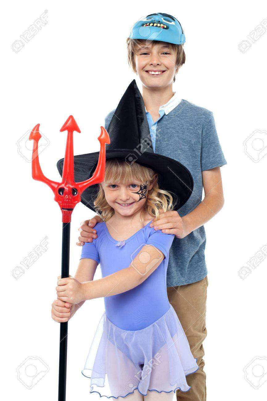 Boy And Girl Wearing Halloween Costume. Dressed As Vampire And ...