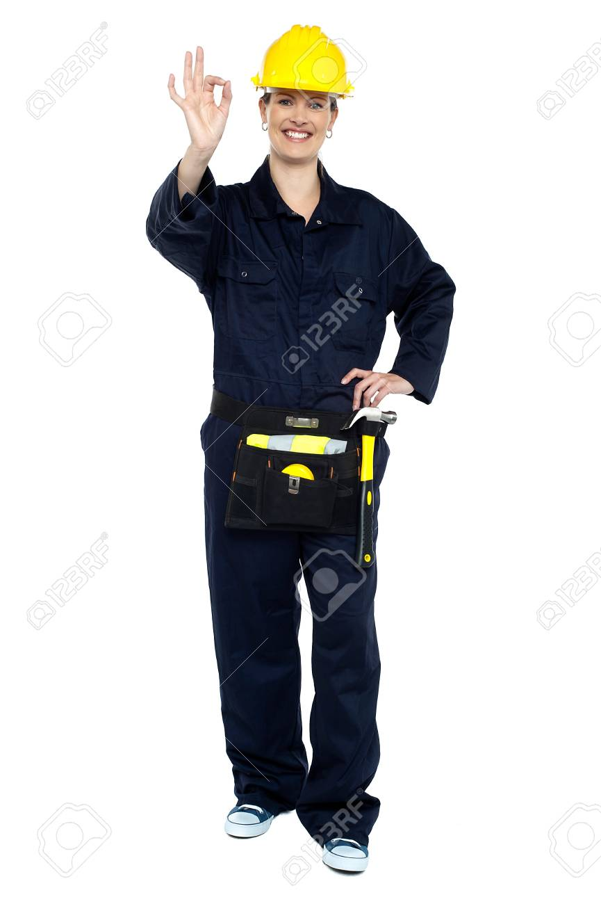 Female worker in jumpsuit showing perfect gesture. Work is good. Stock Photo - 16684959
