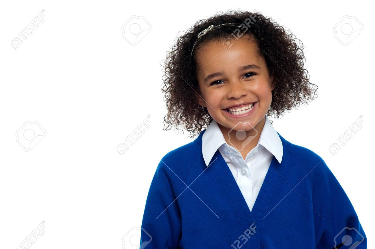 Happy elementary school girl flashing a smile isolated over white. Stock Photo - 16771533