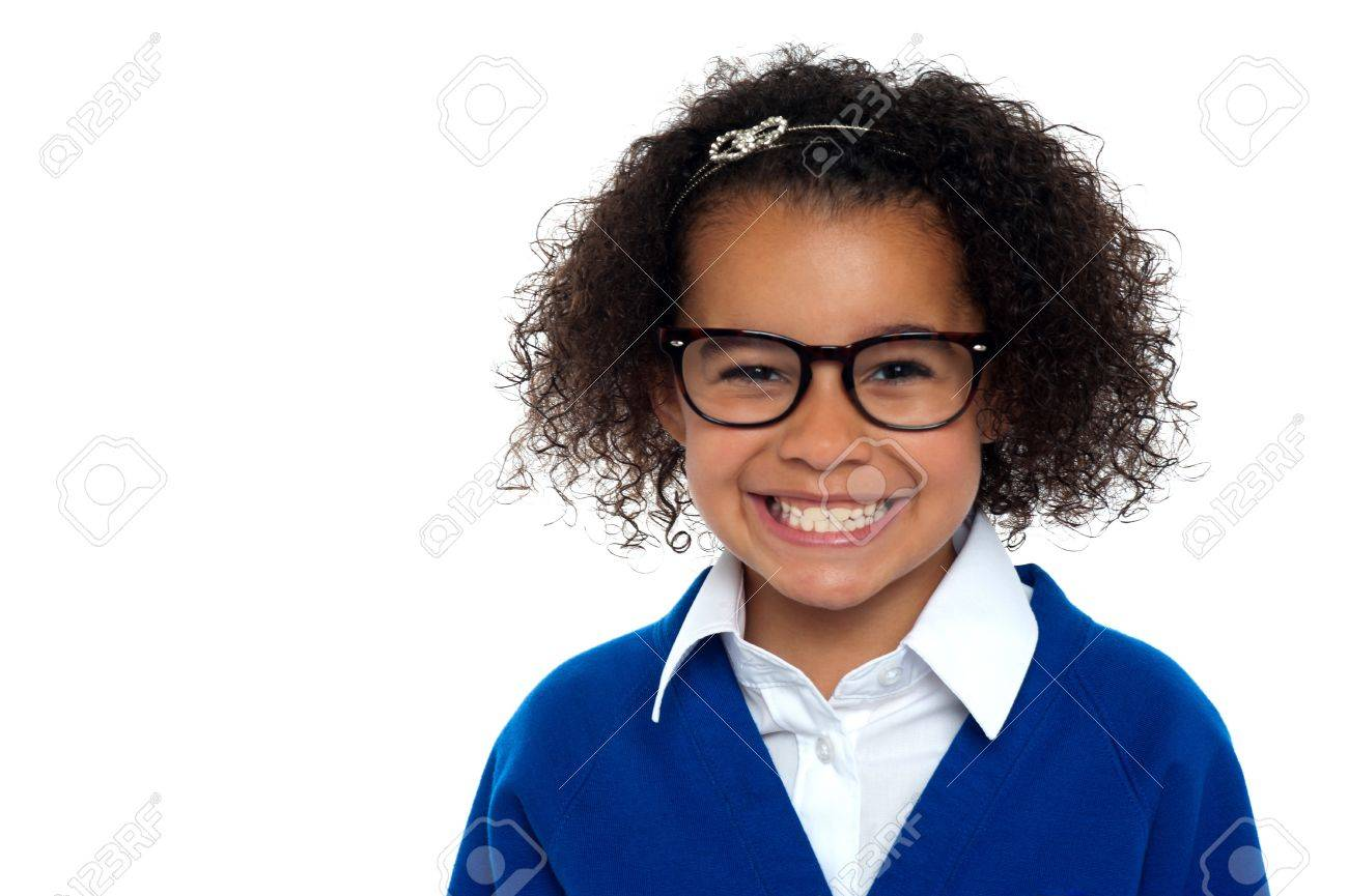 African origin bespectacled primary girl on a white background. Stock Photo - 16771522