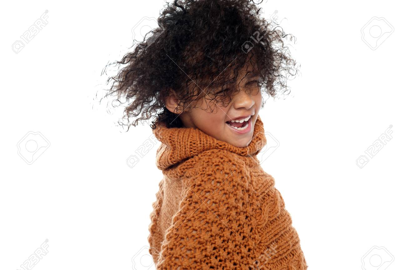Shot of curly haired girl having a great time. Hair dancing in air. Stock Photo - 16771527