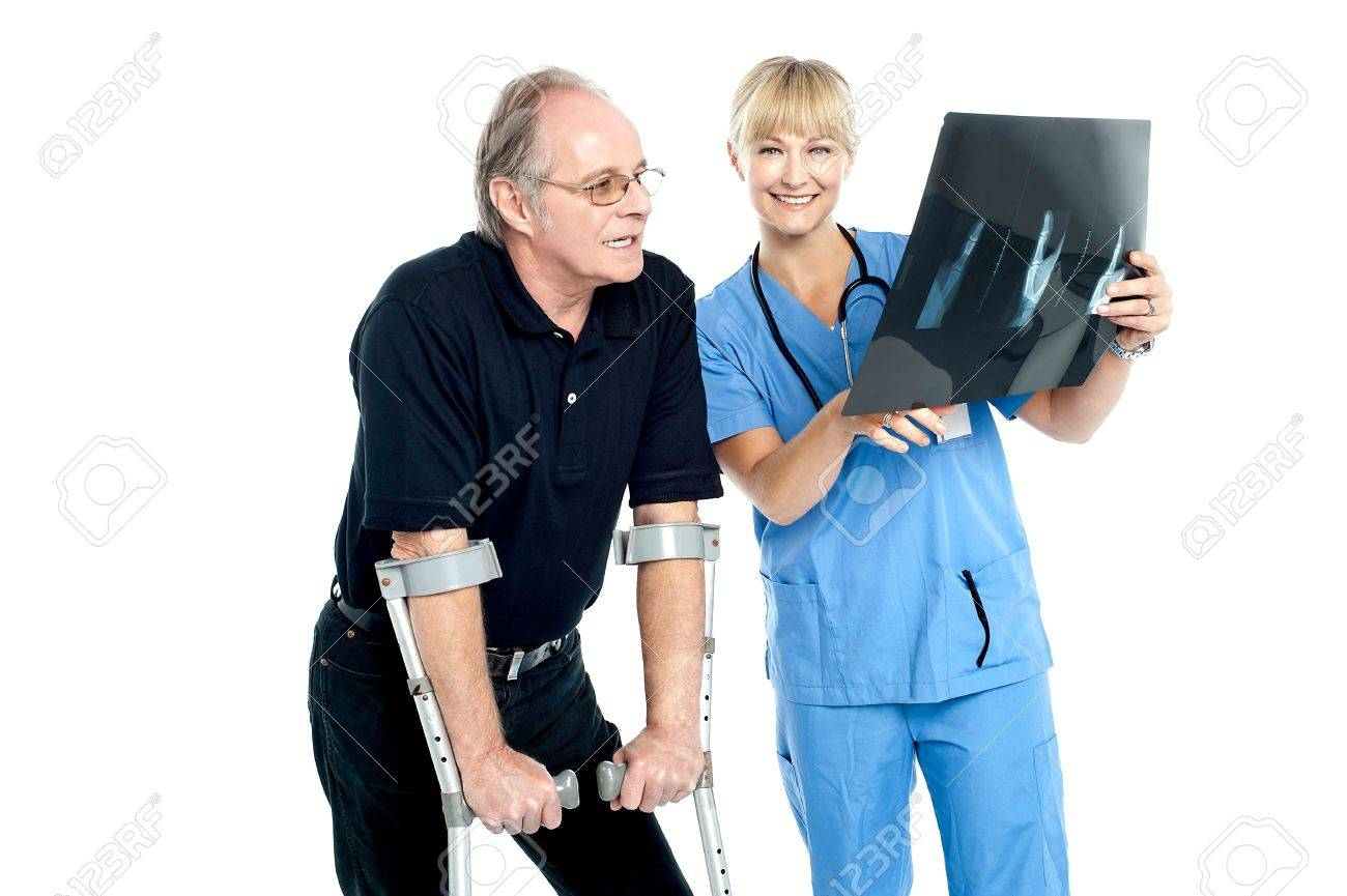 Surgeon showing x-ray sheet to her patient. Damages caused by accident. Stock Photo - 17044529