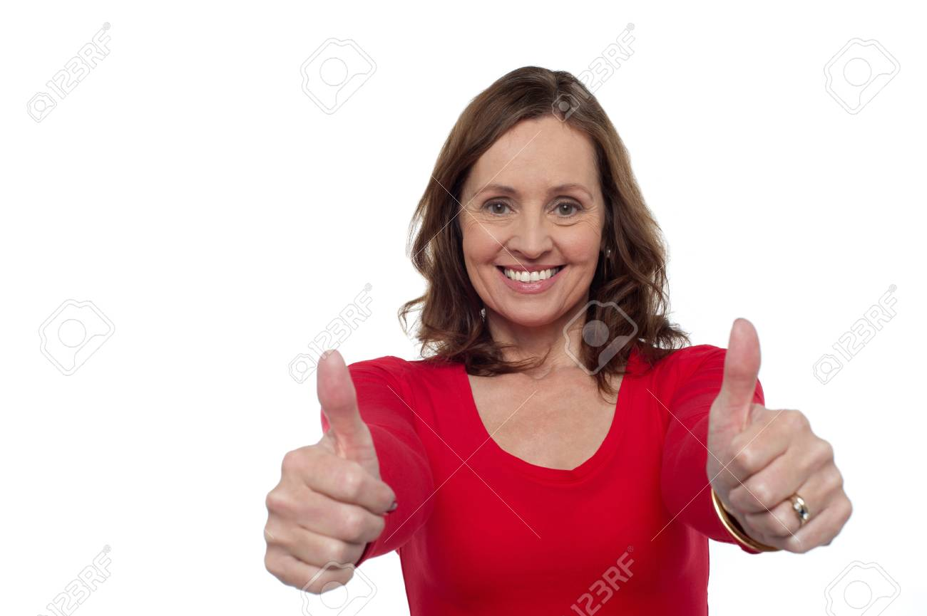 Joyous woman gesturing double thumbs up. Stock Photo - 17204252