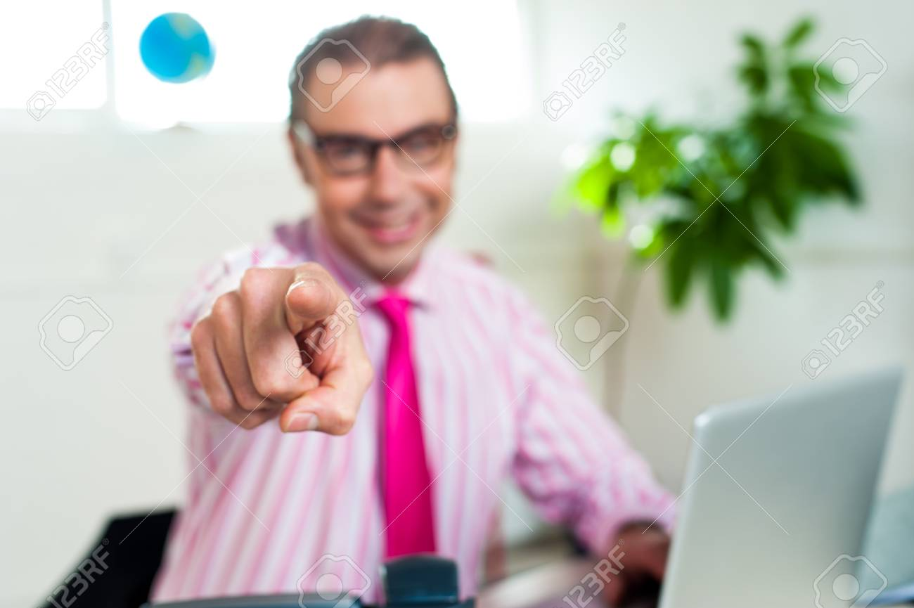Business professional pointing his index finger towards you, wearing spectacles. Stock Photo - 17204247