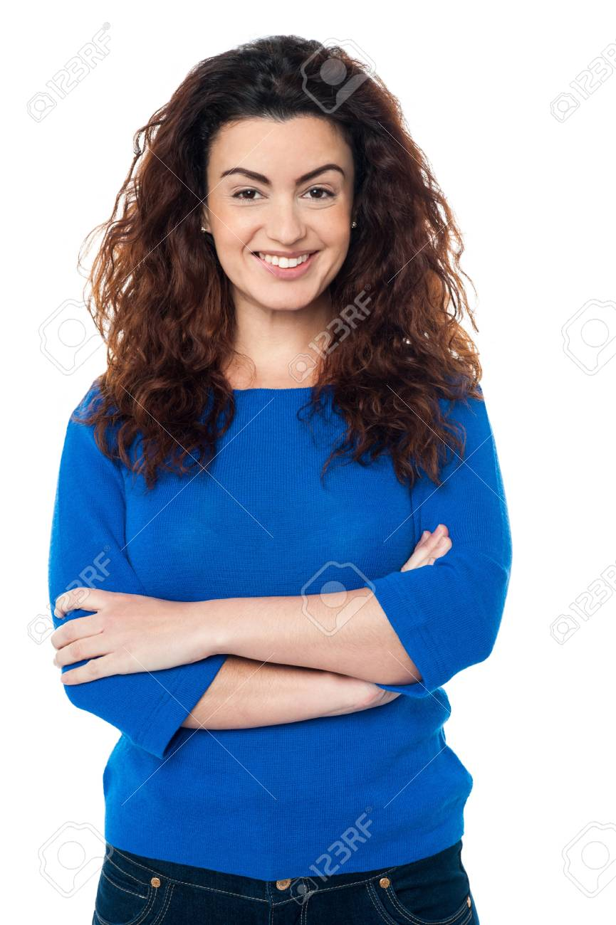 Attractive woman in casuals posing arms crossed, long curly hair. Stock Photo - 17378697