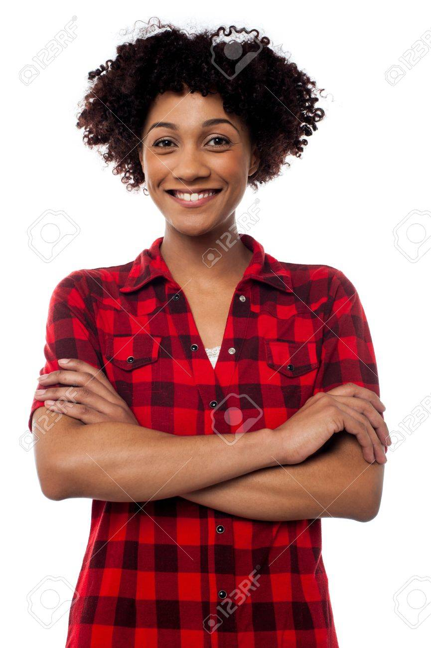 Fashionable young woman in checked shirt posing with arms crossed, half length portrait. Stock Photo - 17378667