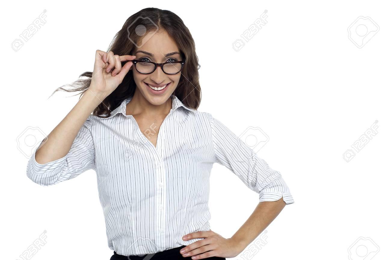 Smiling female executive adjusting her eye wear, half length portrait on white. Stock Photo - 17490362