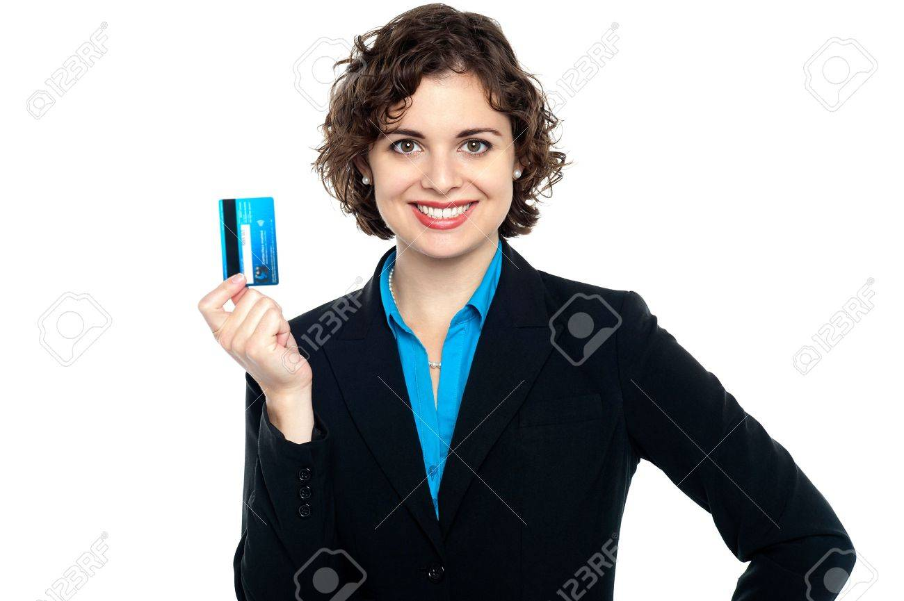 attractive woman holding up credit card to the camera business