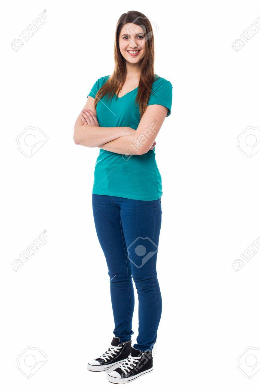 Stylish young female posing before the camera with folded arms, bright smile. Stock Photo - 18021432