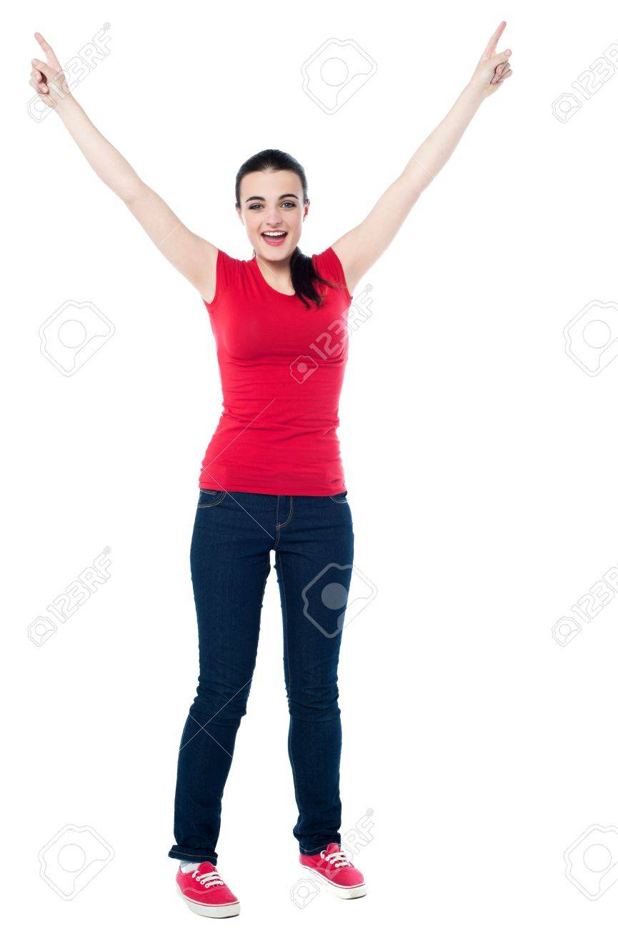 Image of an excited young girl raising her arms. Stock Photo - 21044205