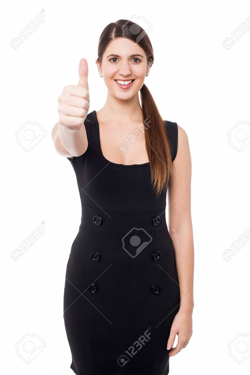 Smiling beautiful woman with success gesture Stock Photo - 21327060