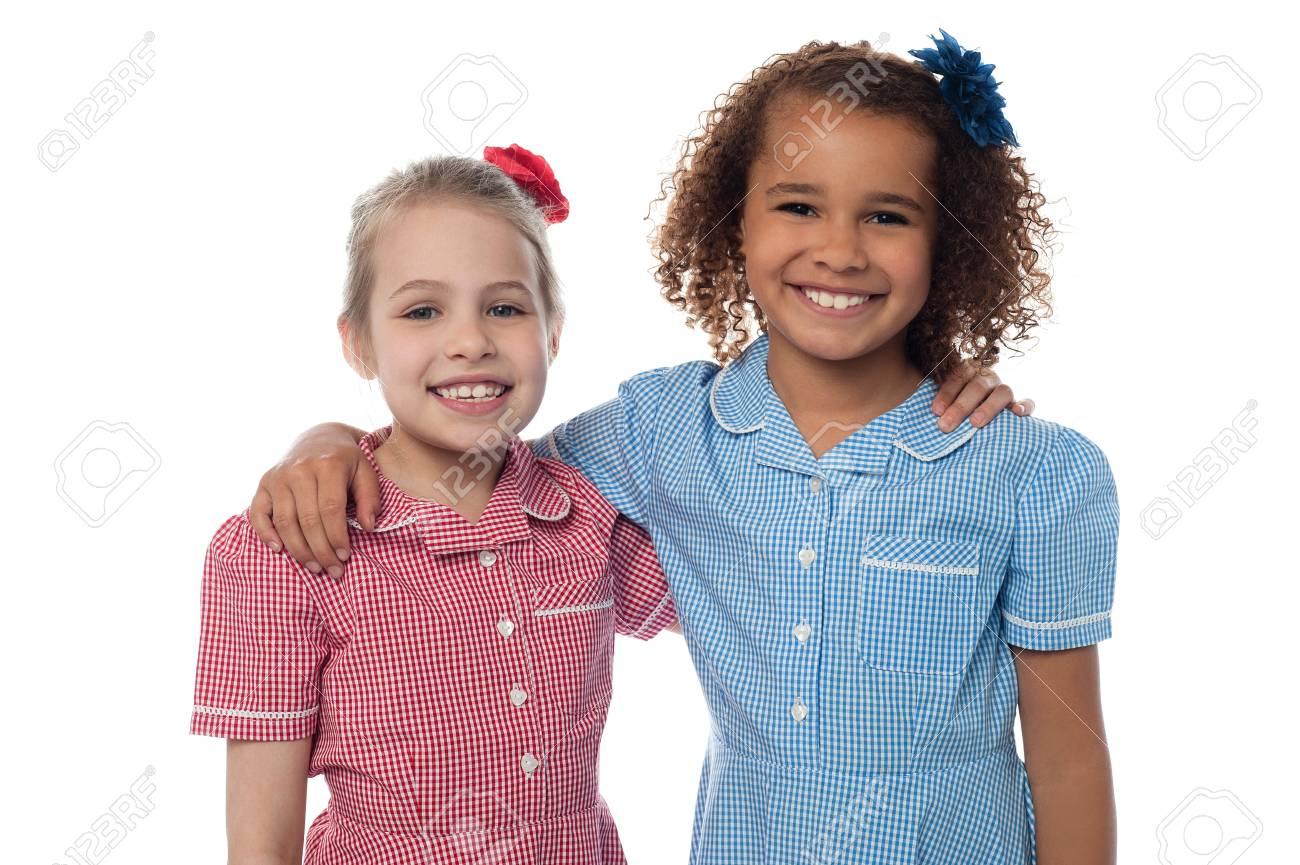 Little school girls posing together Stock Photo - 21332663