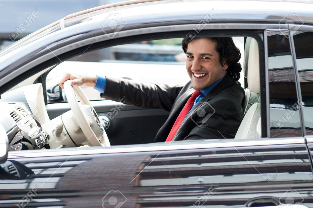 Stock Photo   Young Professional Driving His New Luxury Car
