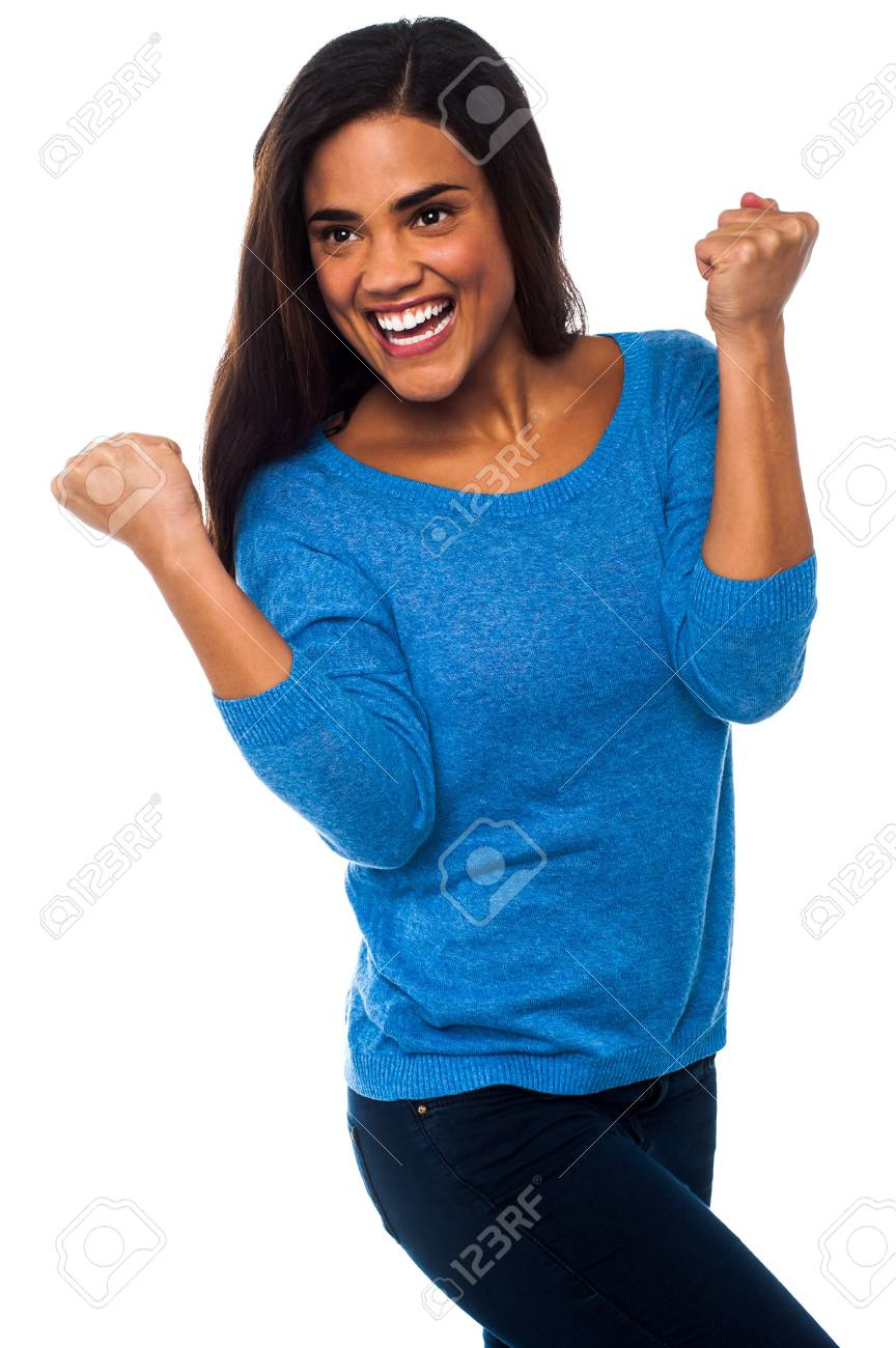 Happy girl clenching her fists in excitement Stock Photo - 21423682
