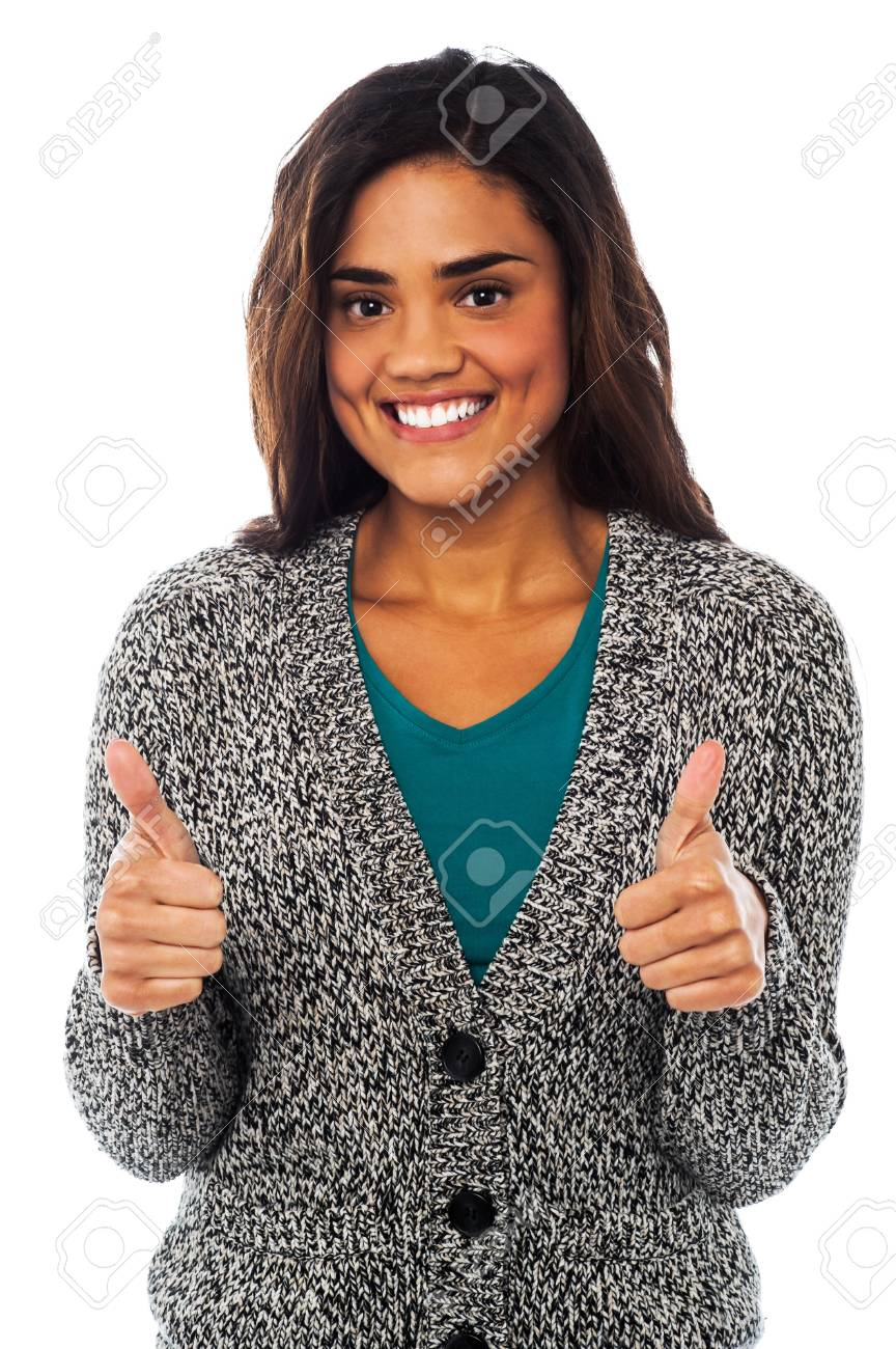 Happy young girl showing double thumbs up to the camera Stock Photo - 21423703