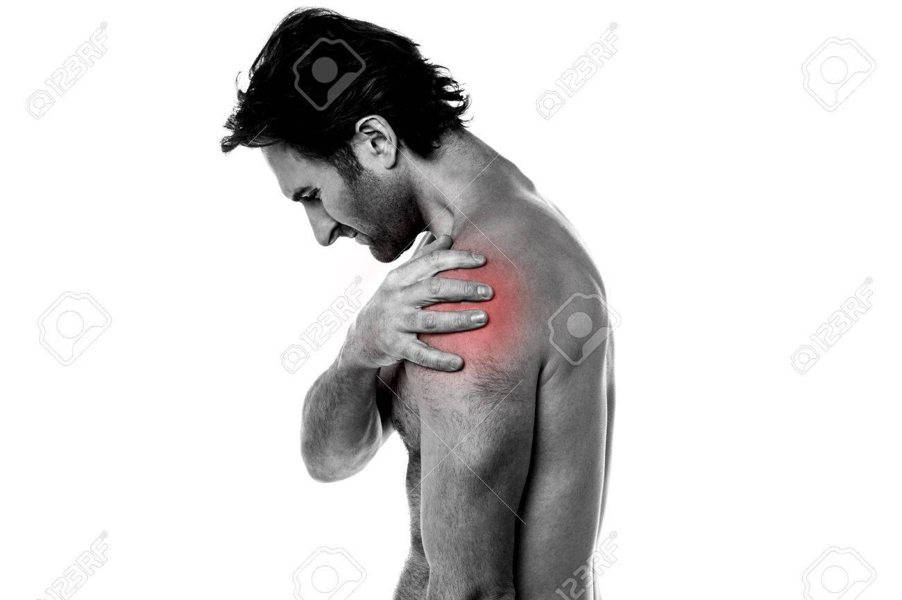Man having shoulder joint pain in his left shoulder Stock Photo - 21429475