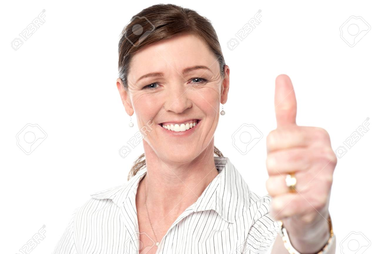 Businesswoman showing thumbs up gesture Stock Photo - 21412120