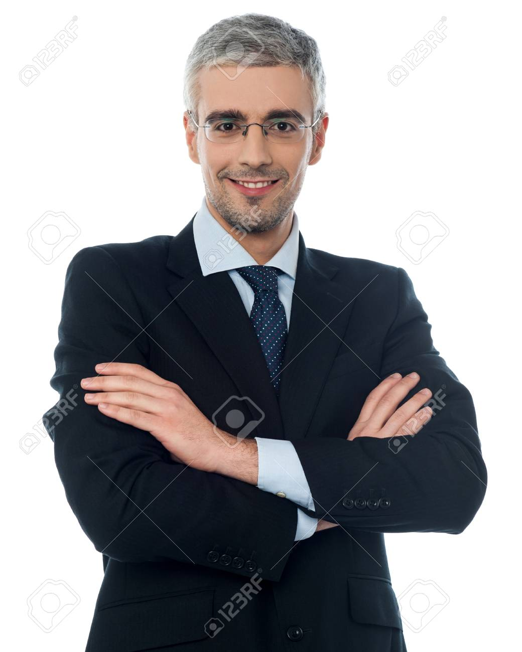 Friendly Businessman In Suit With Crossed Arms