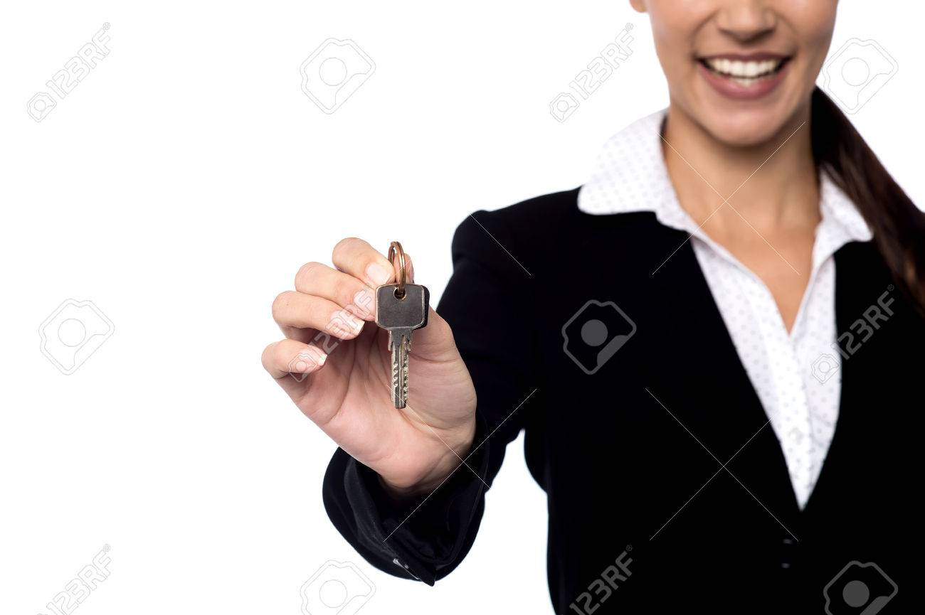 Cropped image of realtor offering house key Stock Photo - 36816127