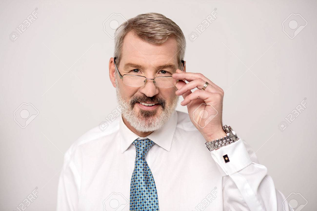 Businessman adjusting his glass for better view Stock Photo - 38278331