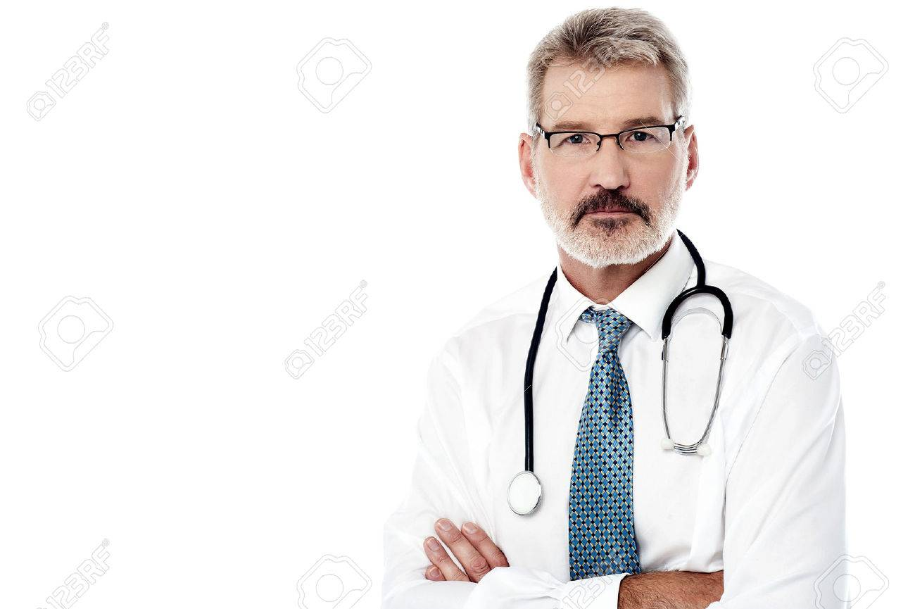 Mature male physician posing with stethoscope over white Stock Photo - 44277776