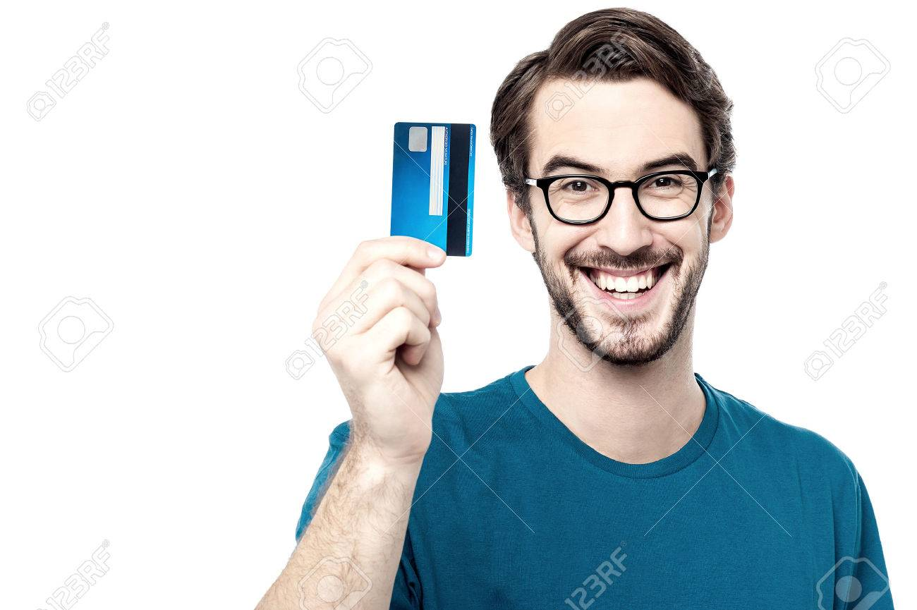 Young man showing credit card Stock Photo - 45930439