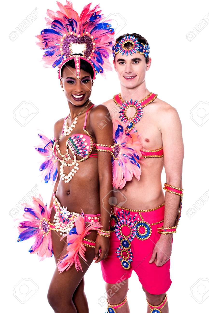 Happy samba dancers posing together in carnival costume