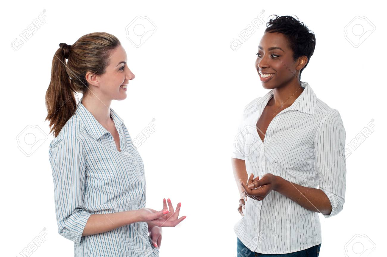 Women talking to each other, studio shot. - 54437890