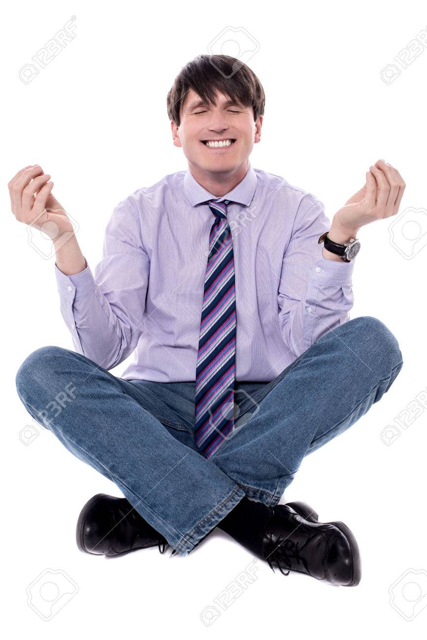 Businessman meditating in lotus position isolated over white. - 60379838