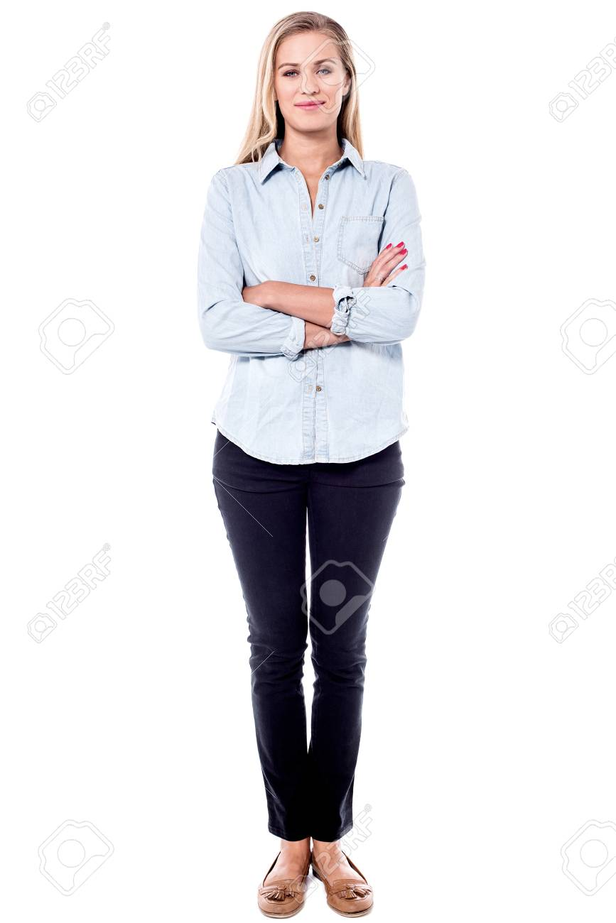 Full length image of female model with crossed arms. - 60379876