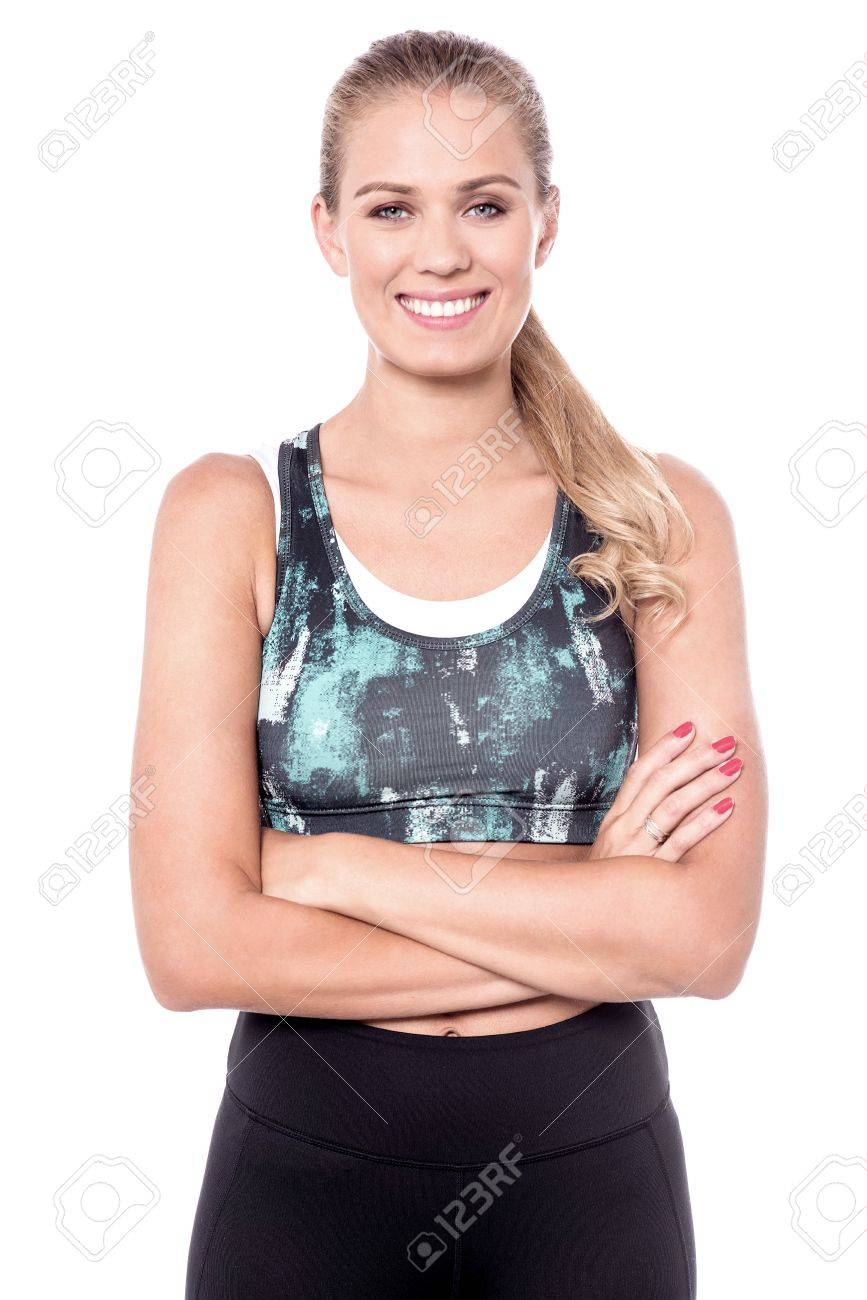Smiling woman in trendy wear looking at camera. - 60379877