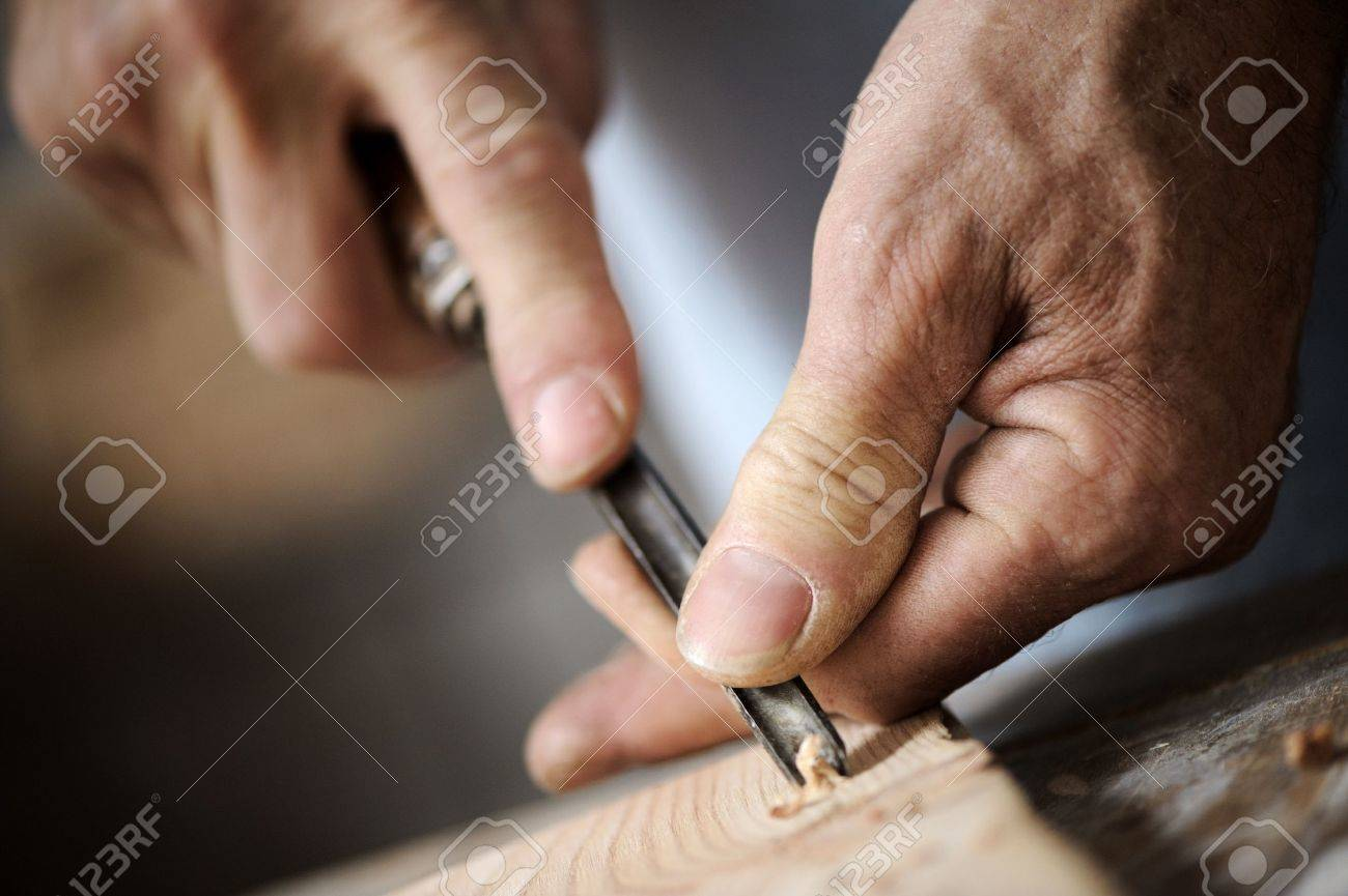 hands of the craftsman carve a bas-relief with a gouge Stock Photo - 11974021