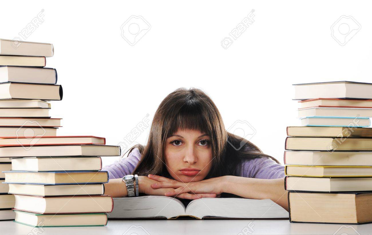 Tired of studies, young Woman is sitting on her desk with books Stock Photo - 12078978