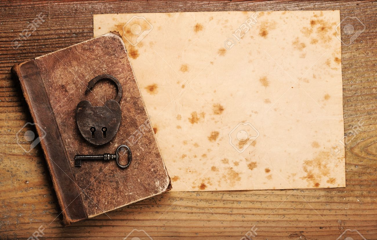 Old Paper Background Texture With Book And Key Stock Photo