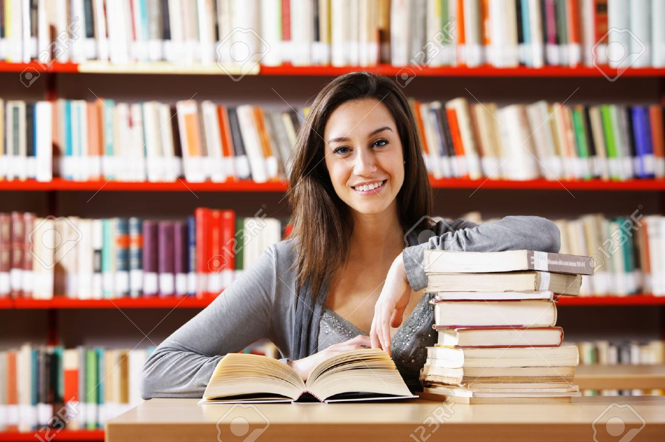 Portrait of a student  girl studying at library Stock Photo - 12844427