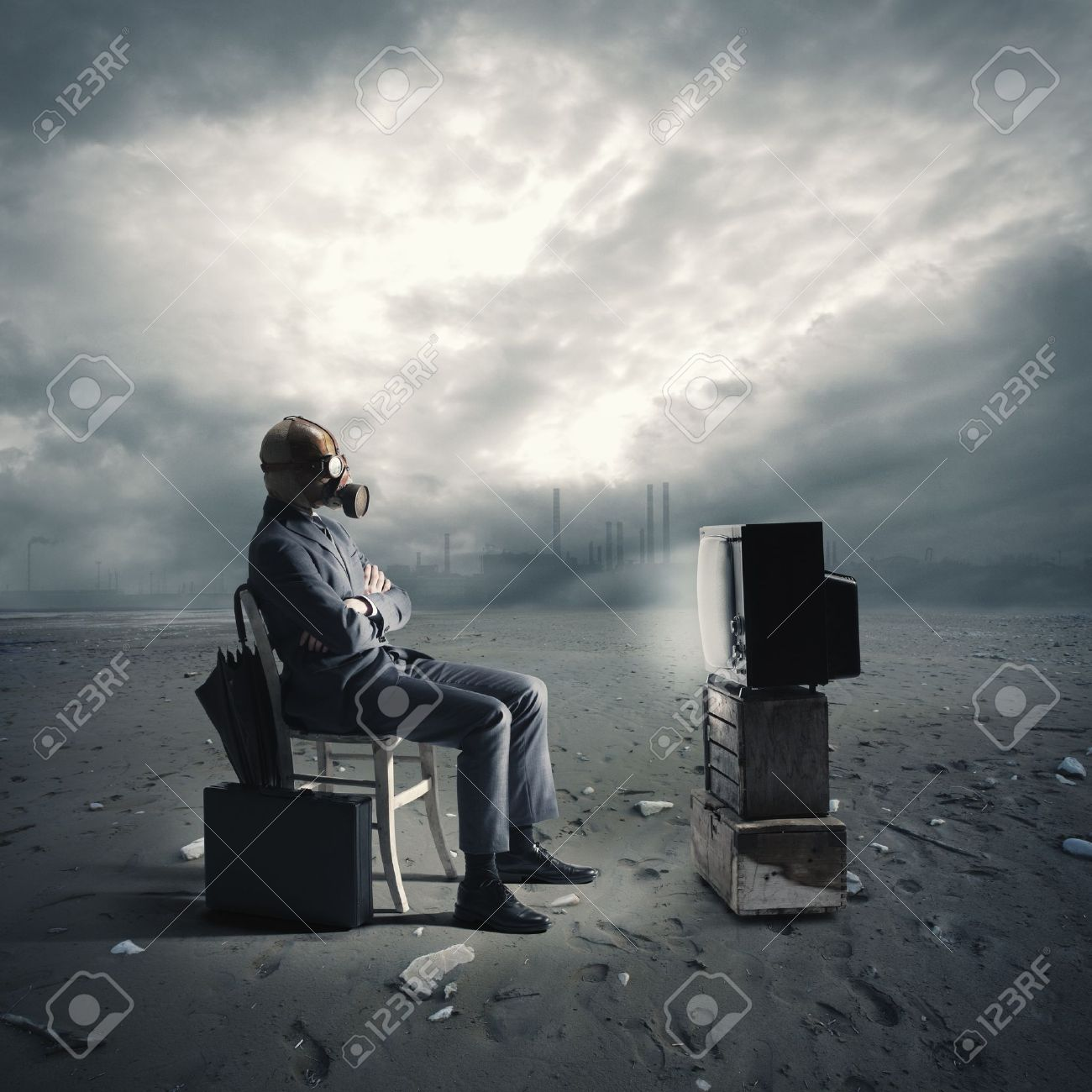 businessman with gas mask watching TV Stock Photo - 13410634