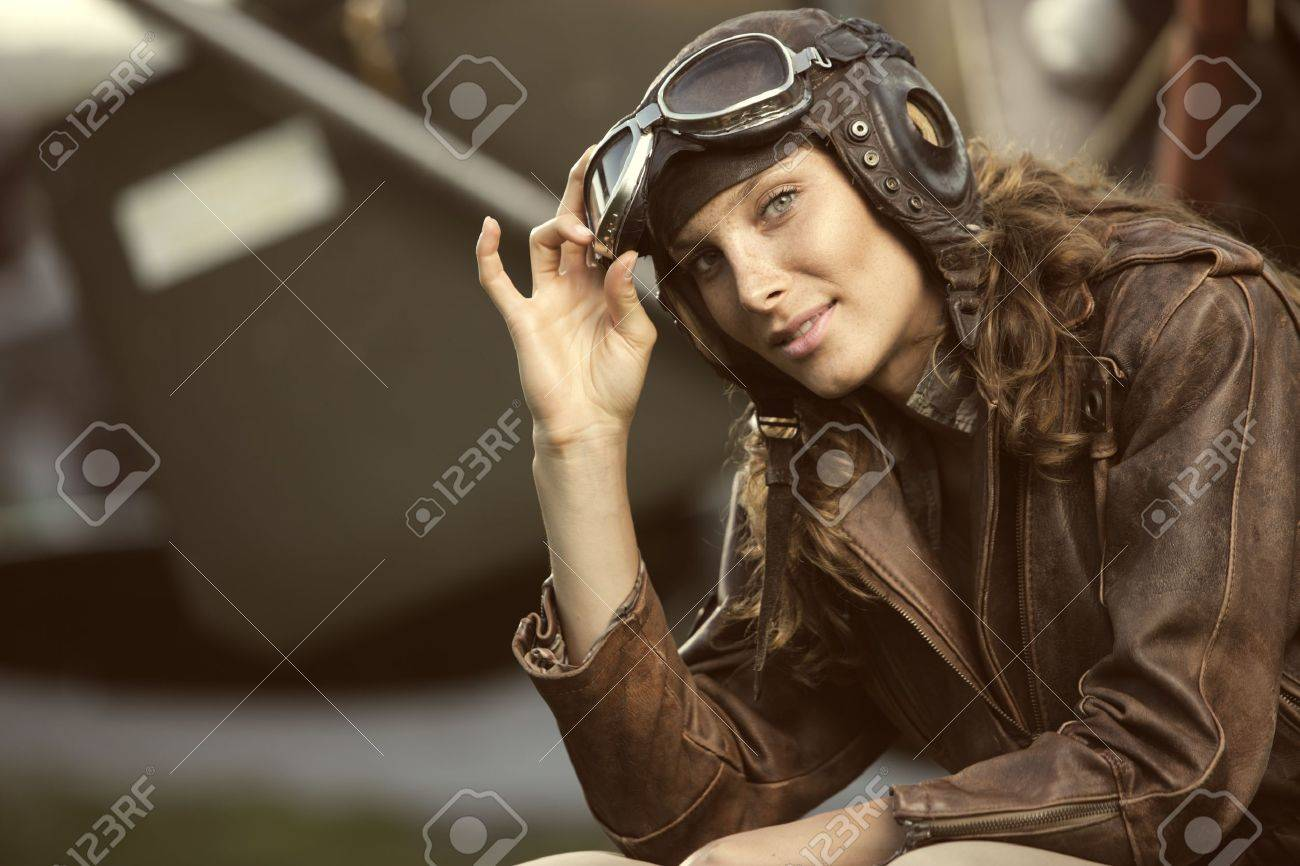 Portrait of young woman airplane pilot. Fashion model Stock Photo - 15075587