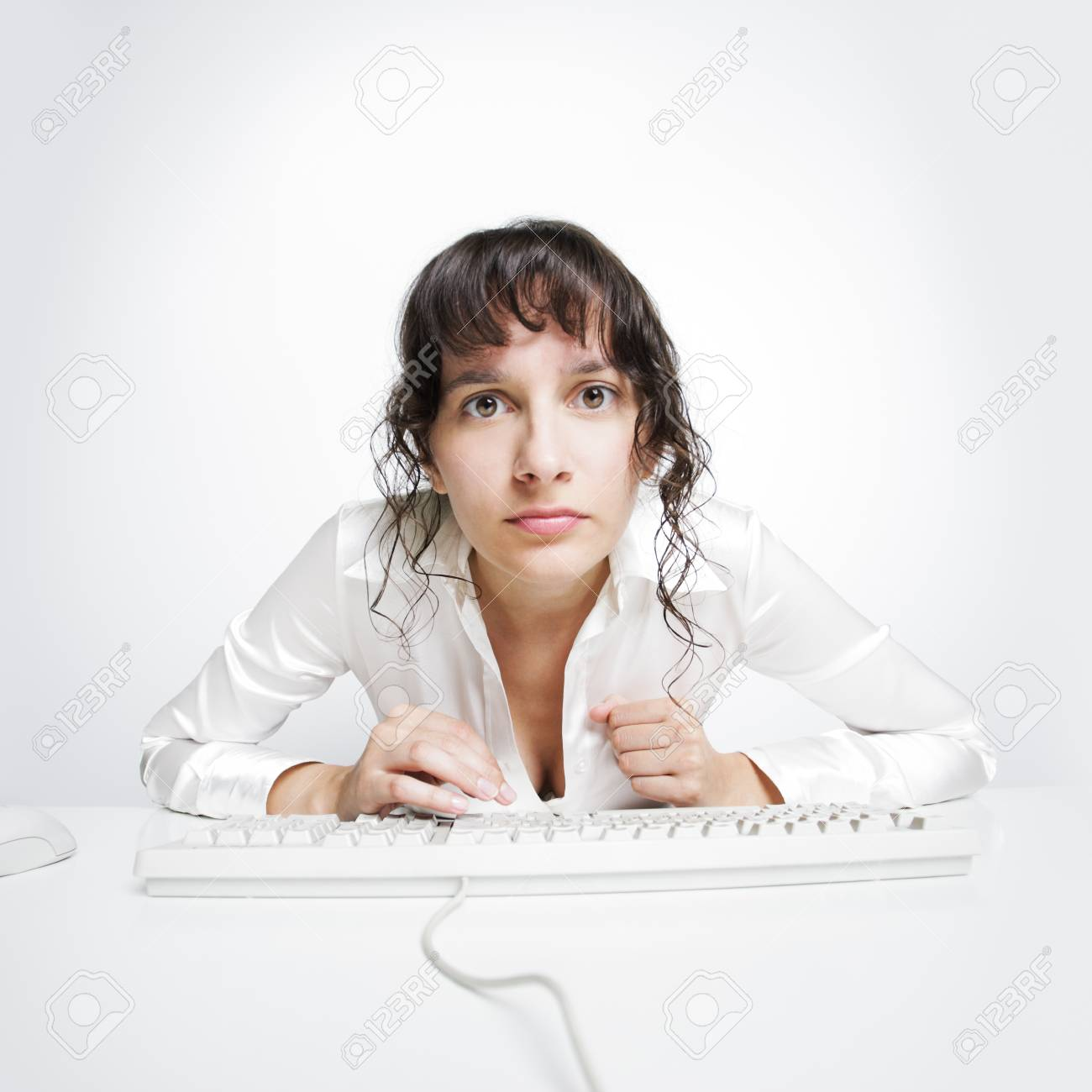Serious frontal portrait of a woman at her office desk Stock Photo - 15037930