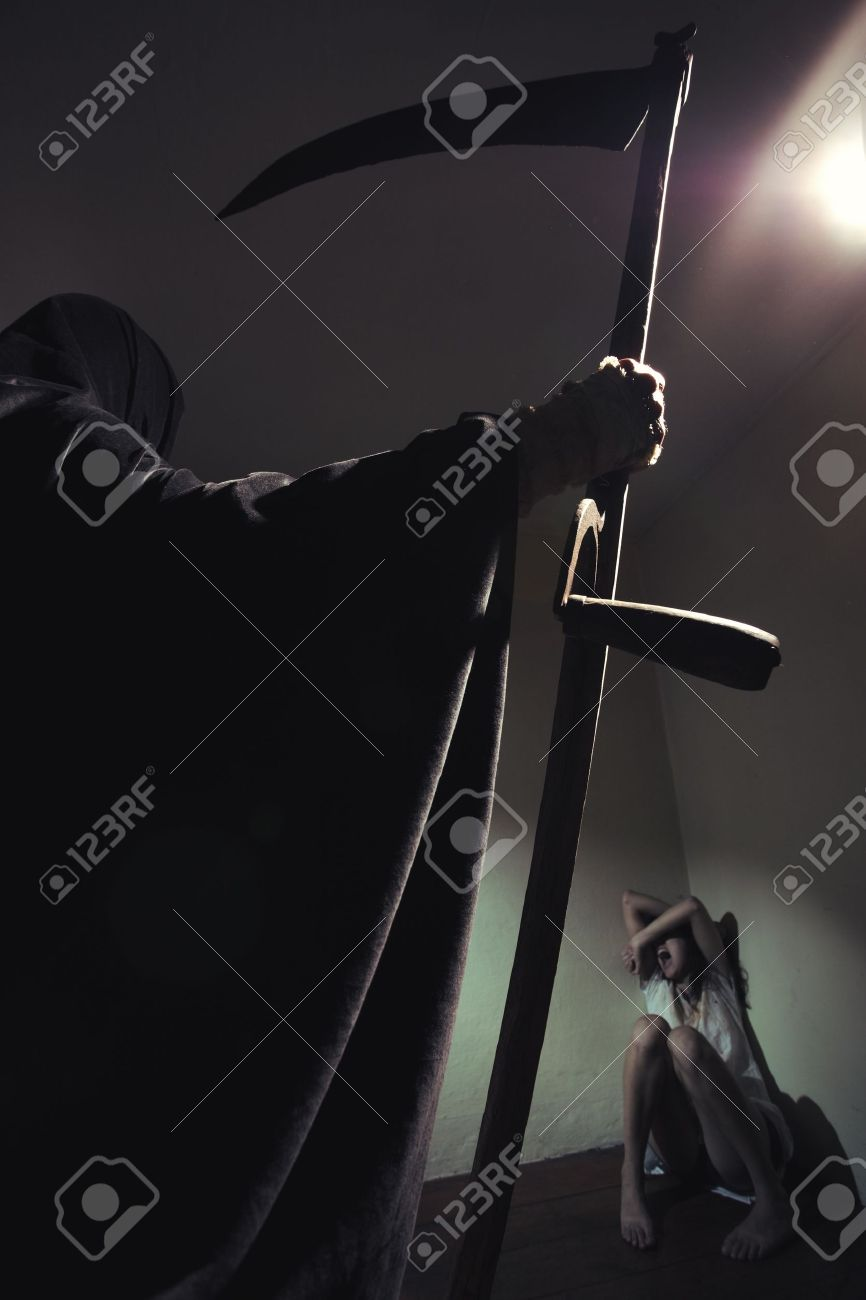 Grim reaper menace a young woman scared Stock Photo - 15045251