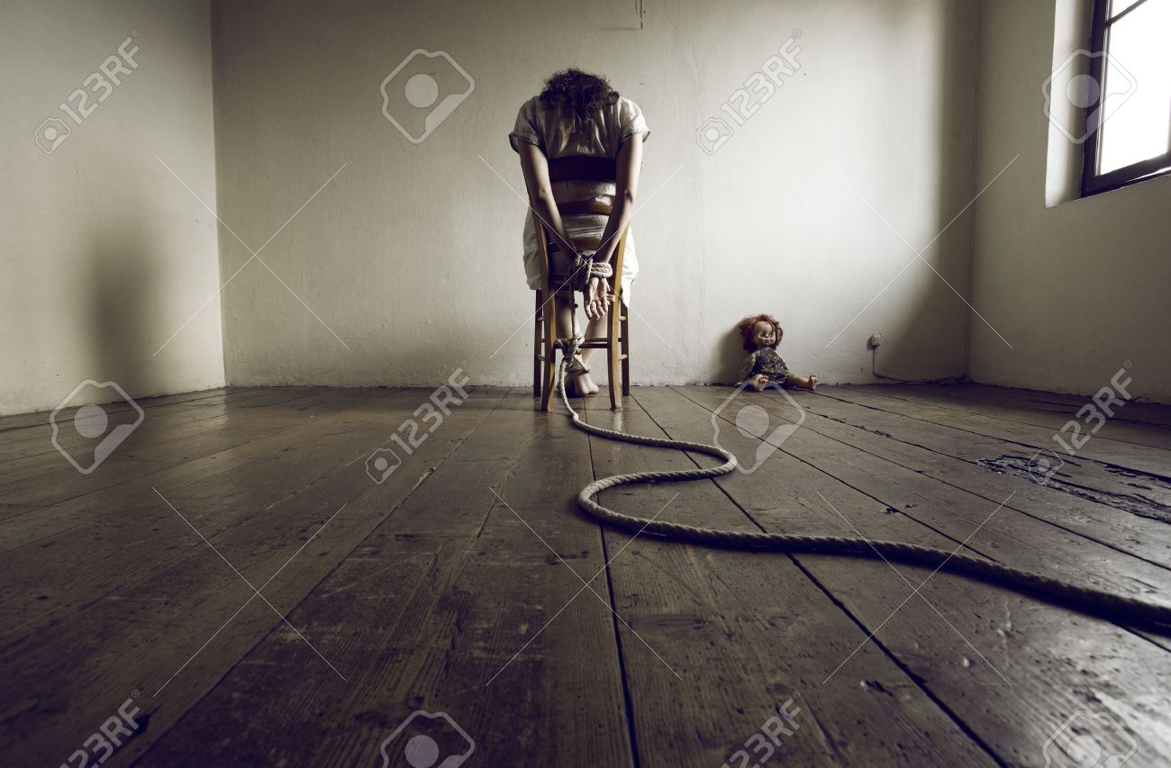 Young Woman Tied To A Chair In Empty Room Stock Photo Picture And
